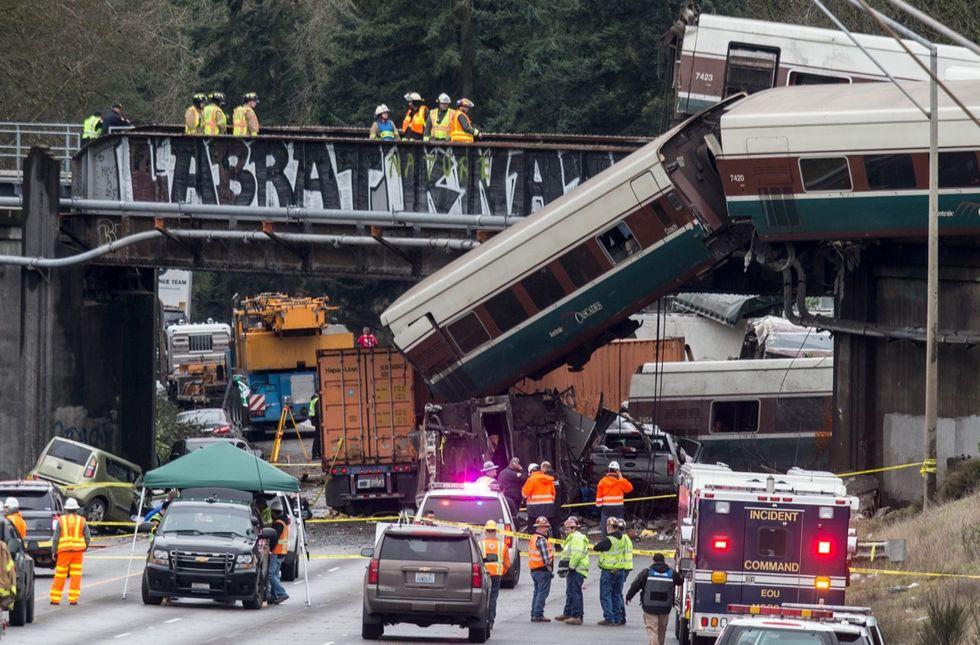 Amtrak Train Derailment South Of Tacoma, Washington Leaves Train Car Dangling Onto Highway