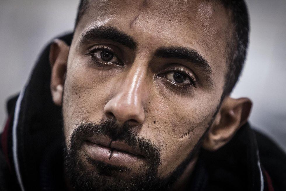 I migranti a bocca cucita e altre foto dal Cie di Ponte Galeria