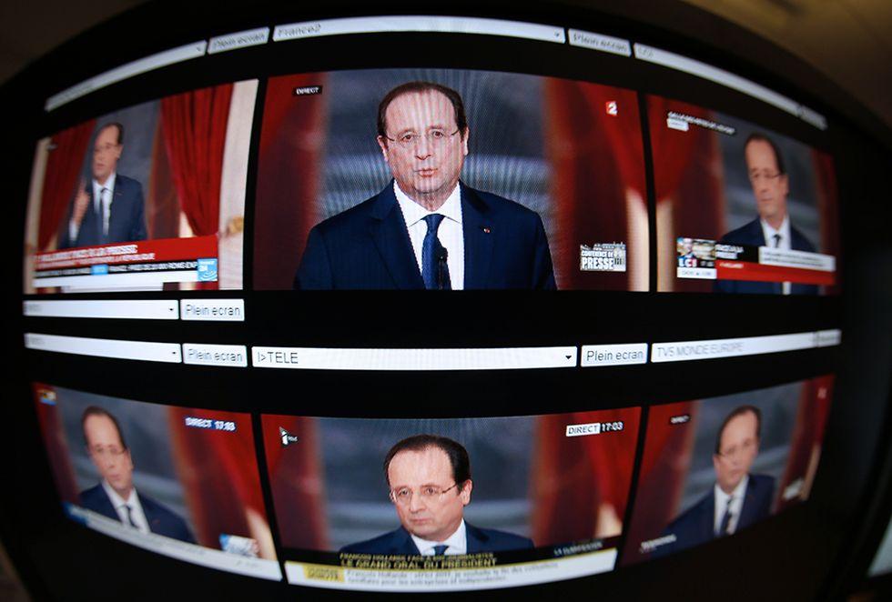 Hollande risponde su Julie Gayet e altre foto del giorno, 14.1.2014
