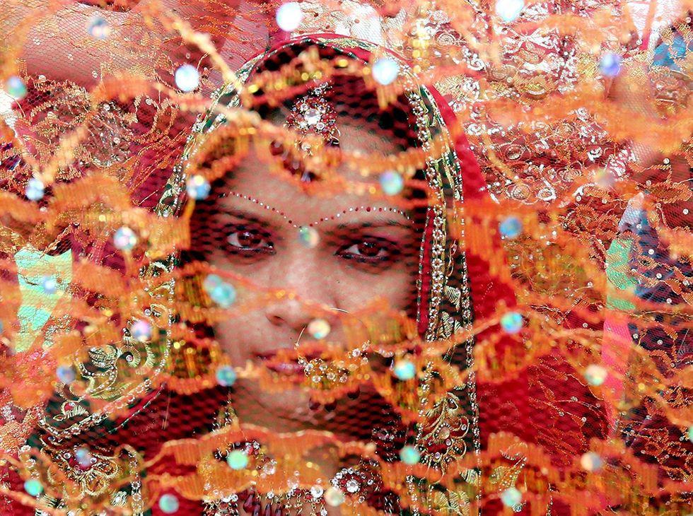 Una sposa di Bhopal e altre foto del giorno, 24.2.2014