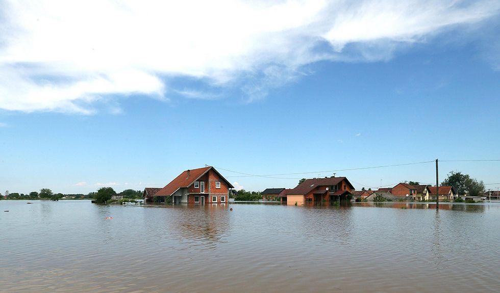 Le alluvioni nei Balcani e altre foto del giorno, 20.05.2014