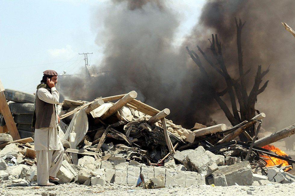 Strage al mercato in Afghanistan e altre foto del giorno, 15.07.2014