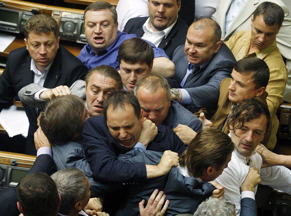 Rissa in Parlamento a Kiev e altre foto del giorno, 22.07.2014