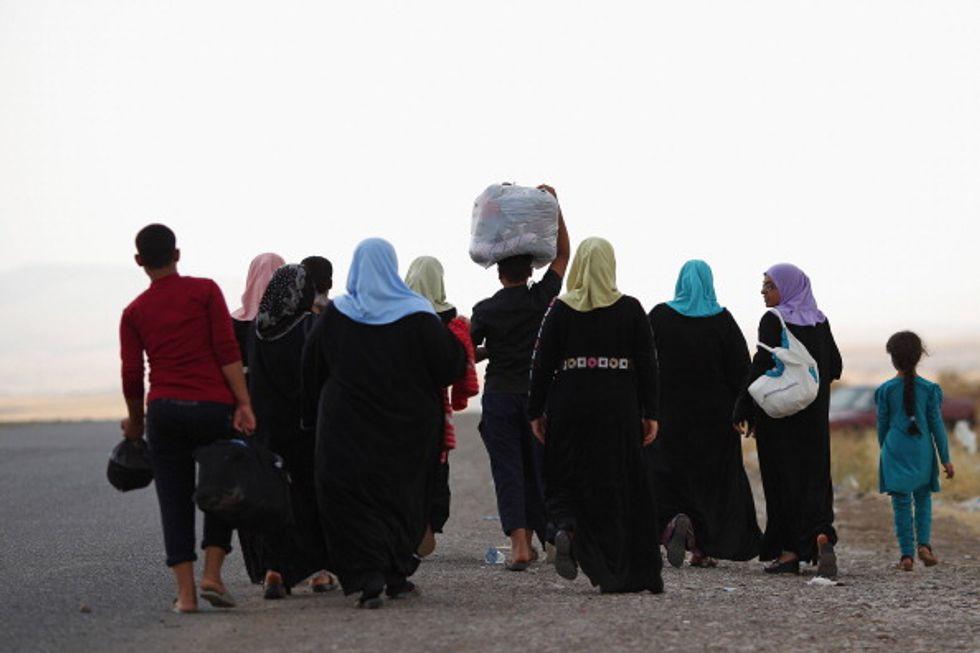 Cristiani in fuga dall'Iraq, nel mirino di Isis