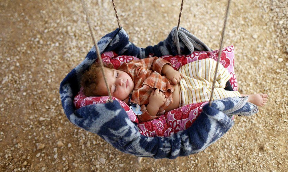 I volti dei bambini fuggiti dalla guerra in Siria